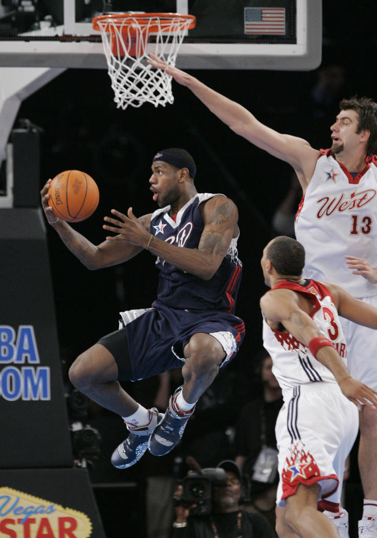 LeBron James of the Cleveland Cavaliers shoots around Mehmet Okur, (13) of the Utah Jazz, right, during the NBA All-Star basketball game in Las Vegas on Sunday, Feb. 18, 2007. The Western Conferen ...