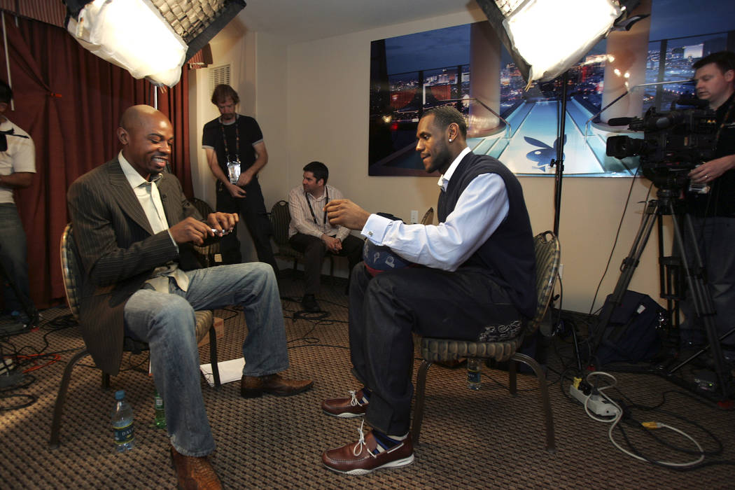 ESPN basketball commentator and former UNLV basketball player Greg Anthony, left, prepares to interview NBA Western Conference player LeBron James, who plays with the Cleveland Cavaliers, during a ...