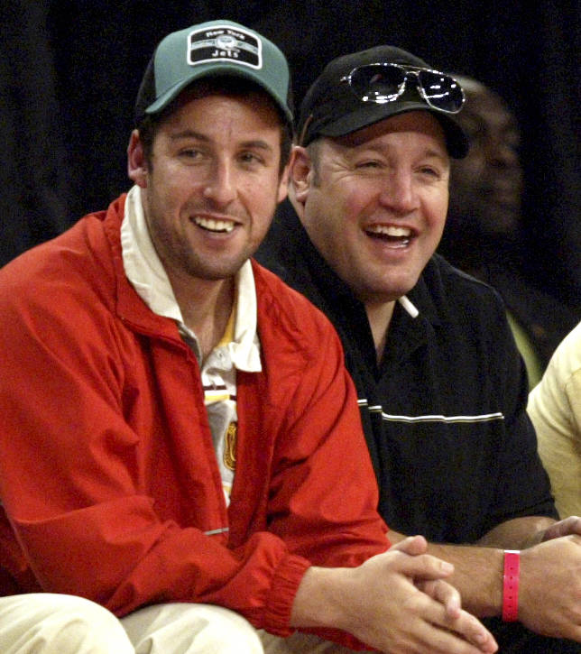 Actor Adam Sandler, left, and Kevin James laugh during the NBA All-Star basketball game at the Thomas & Mack Center Sunday, Feb. 18, 2007, in Las Vegas. Singer Christina Aguilera performs at ha ...