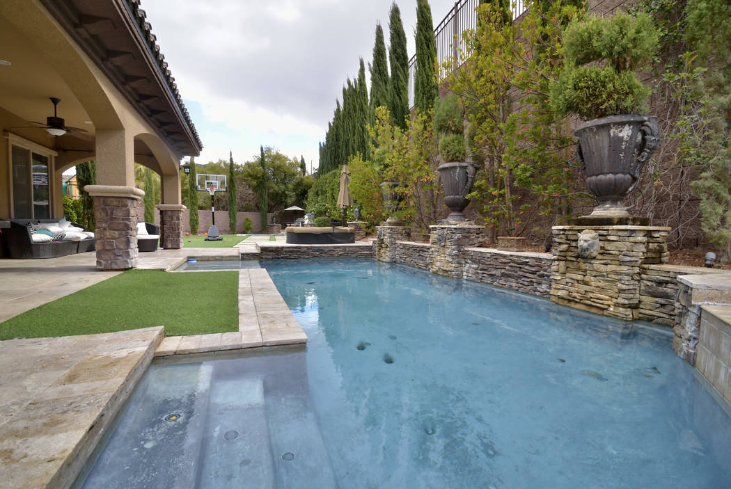 "Bristol and Aubrey Marunde, the stars of HGTVs ""Flip or Flop Vegas,"" have created a backyard that provides activities for the family. (Bill Hughes/Real Estate Millions)"
