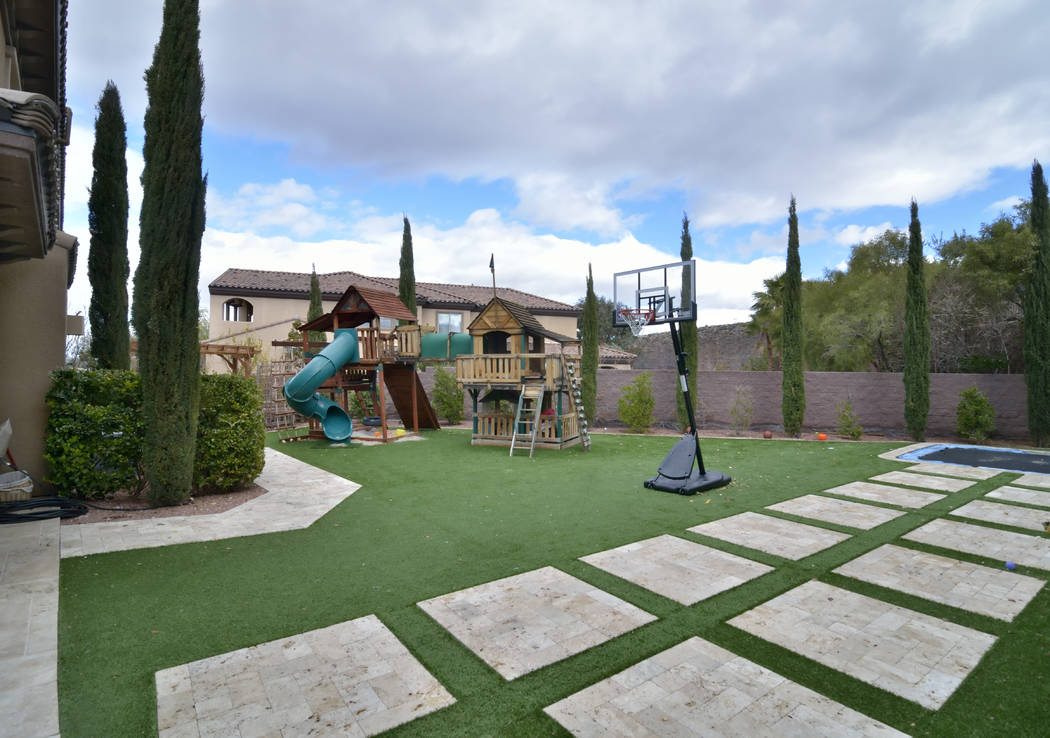"Bristol and Aubrey Marunde, the stars of HGTVs ""Flip or Flop Vegas,"" made the large backyard a fun place for the family. (Bill Hughes/Real Estate Millions)"