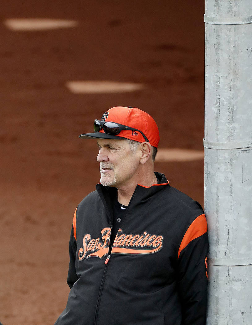 San Francisco Giants manager Bruce Bochy watches his team during a baseball spring training practice, in Scottsdale, Ariz., Feb. 13, 2019. Bochy says he will retire after this season, his 25th as ...