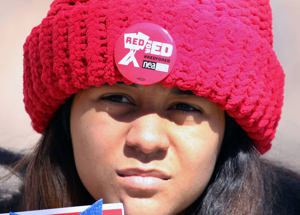 Leslie Long, 15, wears ''Red for Ed'' pin as she demonstrates her support for the Red for Ed movement outside of the Grant Sawyer Building on Monday, Feb. 18, 2019, in Las Vegas. Educators dressed ...