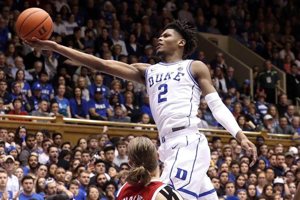 Duke's Cam Reddish (2) drives to the hoop against North Carolina State's Wyatt Walker (33) during the second half of an NCAA college basketball game, in Durham, N.C., Feb. 16, 2019. Duke has recla ...