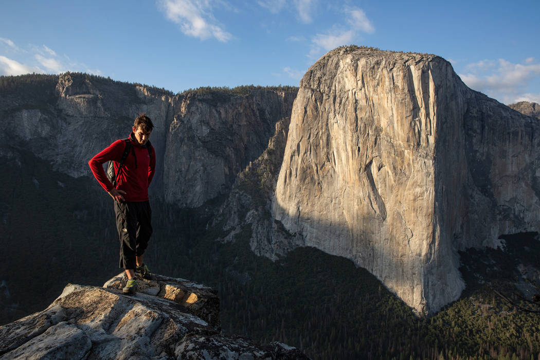 Alex Honnold atop Lower Cathedral withEl Capitan in the background,Yosemite National Park, CA. (National Geographic/Samuel Crossley)