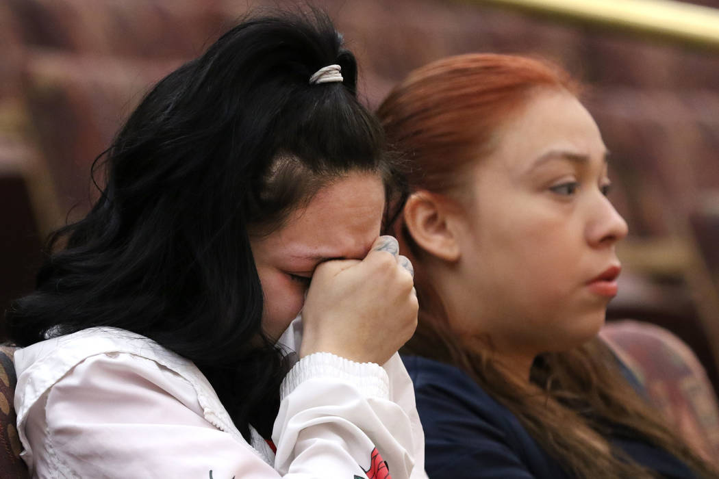 Amber Bustillos, a fiancée of Junior Lopez, a man fatally shot by Las Vegas police in April, weeps as her friend Carla Varela looks on during a public review of Lopez death on Thursday, Feb. ...