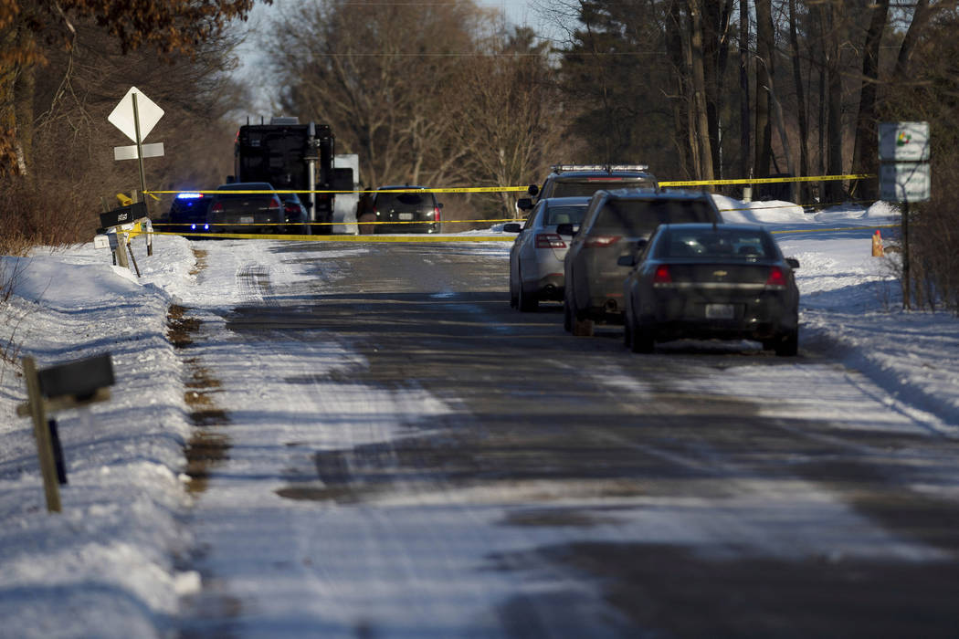 Kent County Sheriff personnel investigate the scene of a fatal shooting on Monday, Feb. 18, 2019, near Cedar Springs, Mich. (Neil Blake/MLive.com/The Grand Rapids Press via AP)