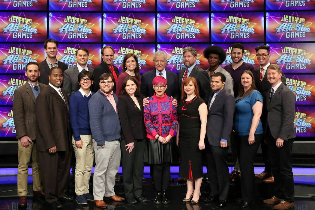 This image released by Jeopardy Productions, Inc. shows, front row from left, Brad Rutter, Colby Burnett, Alan Lin, Seth Wilson, Larissa Kelly, Monica Thieu, Pam Mueller, Matt Jackson, Jennifer Gi ...