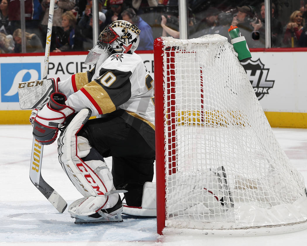 Vegas Golden Knights goaltender Malcolm Subban reacts after giving up a goal to Colorado Avalanche left wing Matt Calvert in the third period of an NHL hockey game Monday, Feb. 18, 2019, in Denver ...