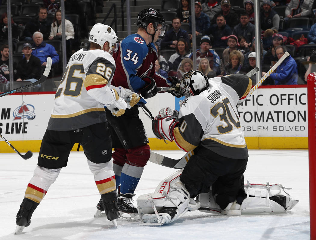 Vegas Golden Knights goaltender Malcolm Subban, right, stops a shot off the stick of Colorado Avalanche center Carl Soderberg after he slipped past Vegas Golden Knights center Paul Stastny, left, ...