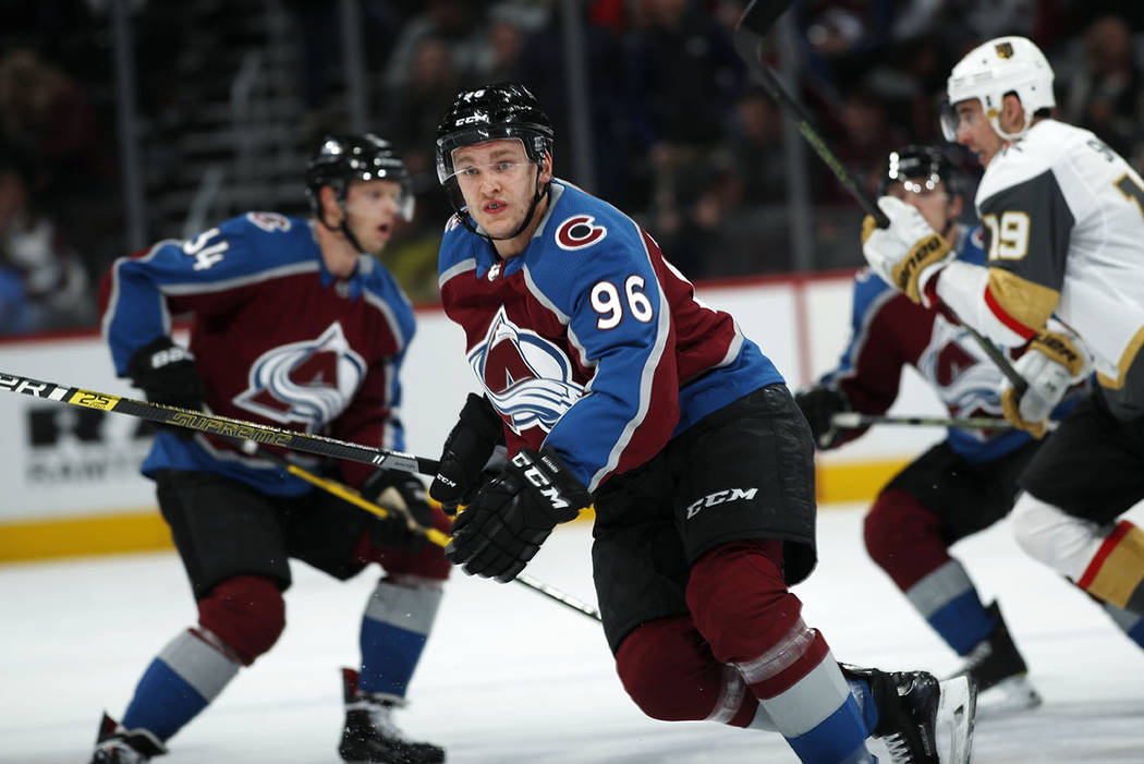 Colorado Avalanche right wing Mikko Rantanen (96) pursues the puck against the Vegas Golden Knights in the first period of an NHL hockey game Monday, Feb. 18, 2019, in Denver. (AP Photo/David Zalu ...