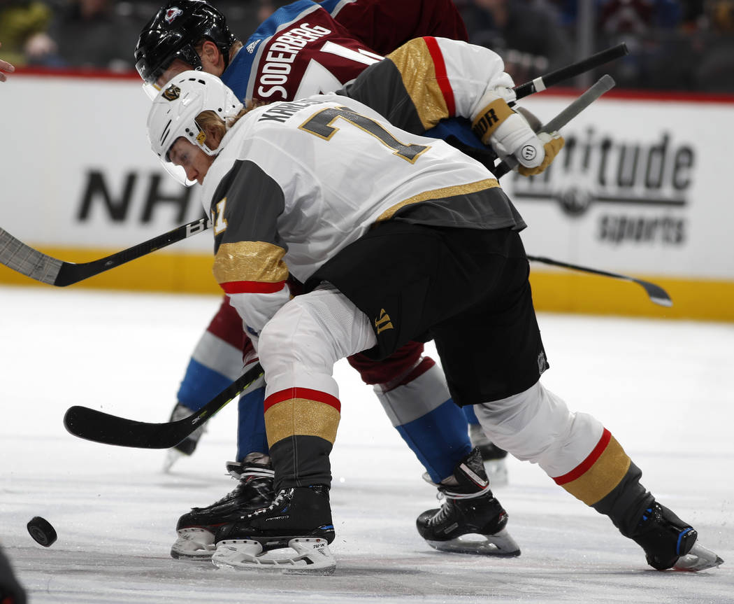 Vegas Golden Knights center William Karlsson, front, fights for control of the puck with Colorado Avalanche center Carl Soderberg in the first period of an NHL hockey game Monday, Feb. 18, 2019, i ...