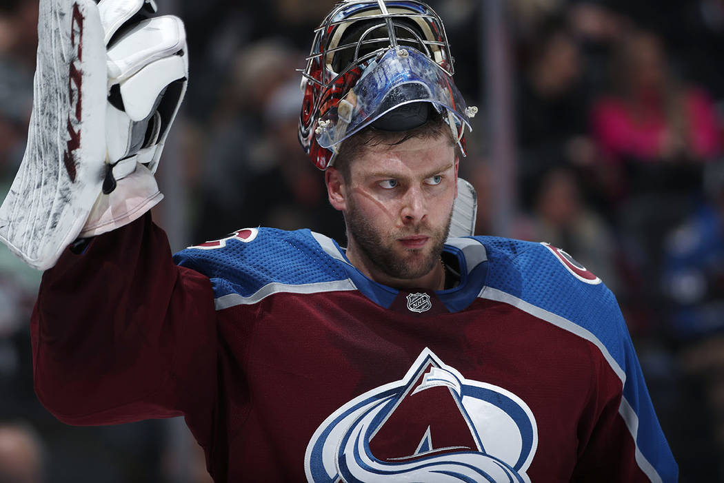 Colorado Avalanche goaltender Semyon Varlamov adjusts his glove during a time out against the Vegas Golden Knights in the second period of an NHL hockey game Monday, Feb. 18, 2019, in Denver. (AP ...
