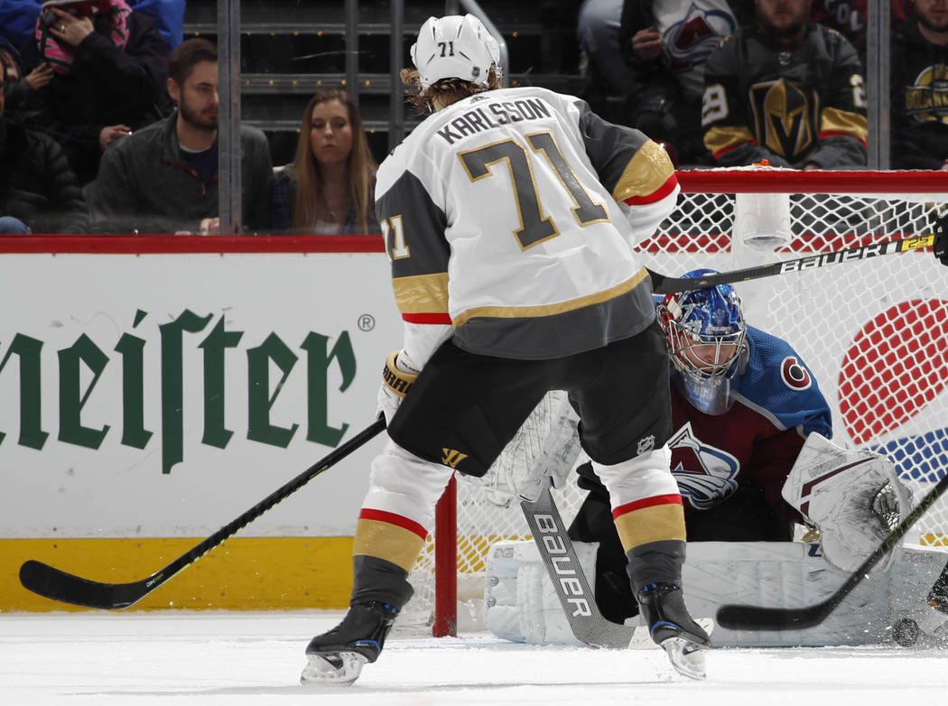 Colorado Avalanche goaltender Semyon Varlamov, right, makes a pad save of a shot off the stick of Vegas Golden Knights center William Karlsson in the third period of an NHL hockey game Monday, Feb ...