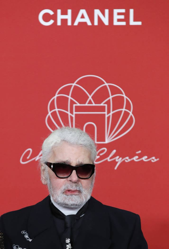 FILE - In this hursday, Nov. 22, 2018 file photo, Karl Lagerfeld poses during the Champs Elysee Avenue illumination ceremony for the Christmas season, in Paris. Chanel's iconic couturier, K ...