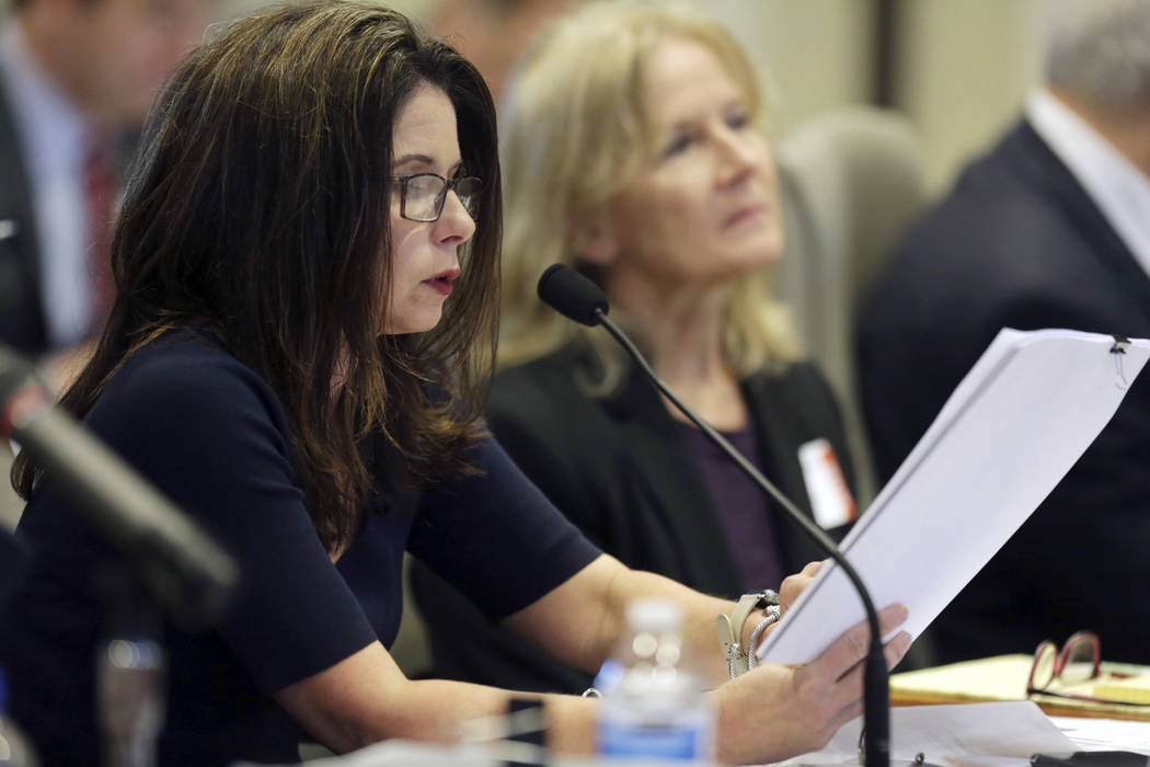 Executive director of the Board of Elections Kim Strach questions the first witness during the public evidentiary hearing on the 9th Congressional District investigation Monday, Feb. 18, 2019, at ...