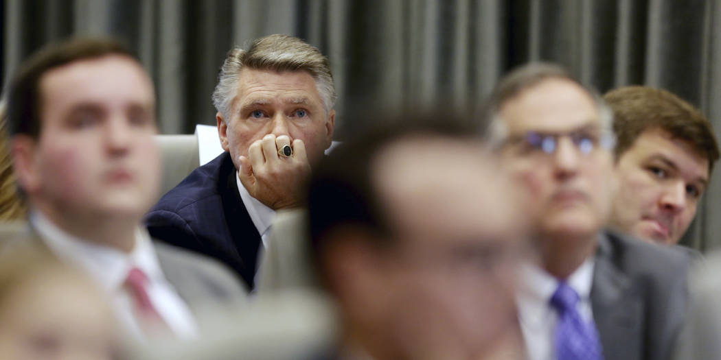 Mark Harris listens to the public evidentiary hearing on the 9th Congressional District investigation Monday, Feb. 18, 2019, at the North Carolina State Bar in Raleigh, N.C. (Juli Leonard/The News ...
