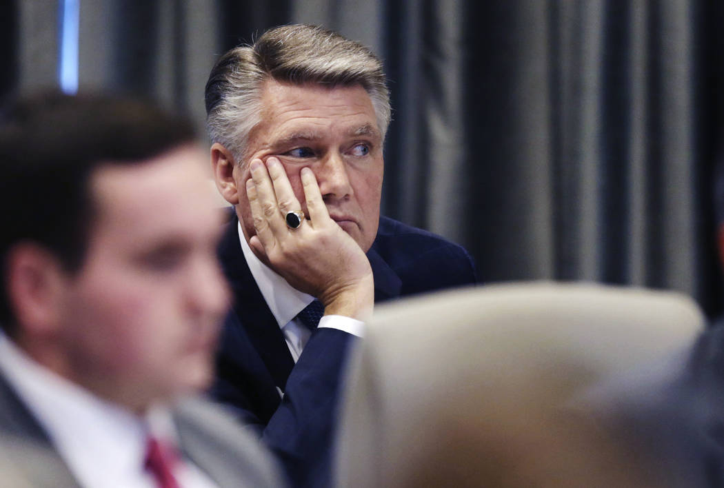 Mark Harris listens during a public evidentiary hearing on the 9th Congressional District investigation at the North Carolina State Bar in Raleigh, N.C., Monday, Feb. 18, 2019. (Juli Leonard/The N ...