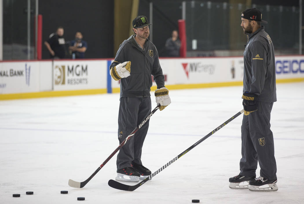 NASCAR driver Kurt Busch, left, takes hockey pointers from Vegas Golden Knights defenseman Deryk Engelland during a media event on Monday, Aug. 13, 2018, at City National Arena to promote the Sout ...
