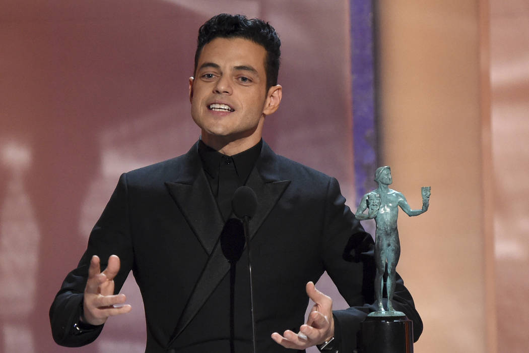 "Rami Malek accepts the award for outstanding performance by a male actor in a leading role for ""Bohemian Rhapsody"" at the 25th annual Screen Actors Guild Awards at the Shrine Auditorium ..."