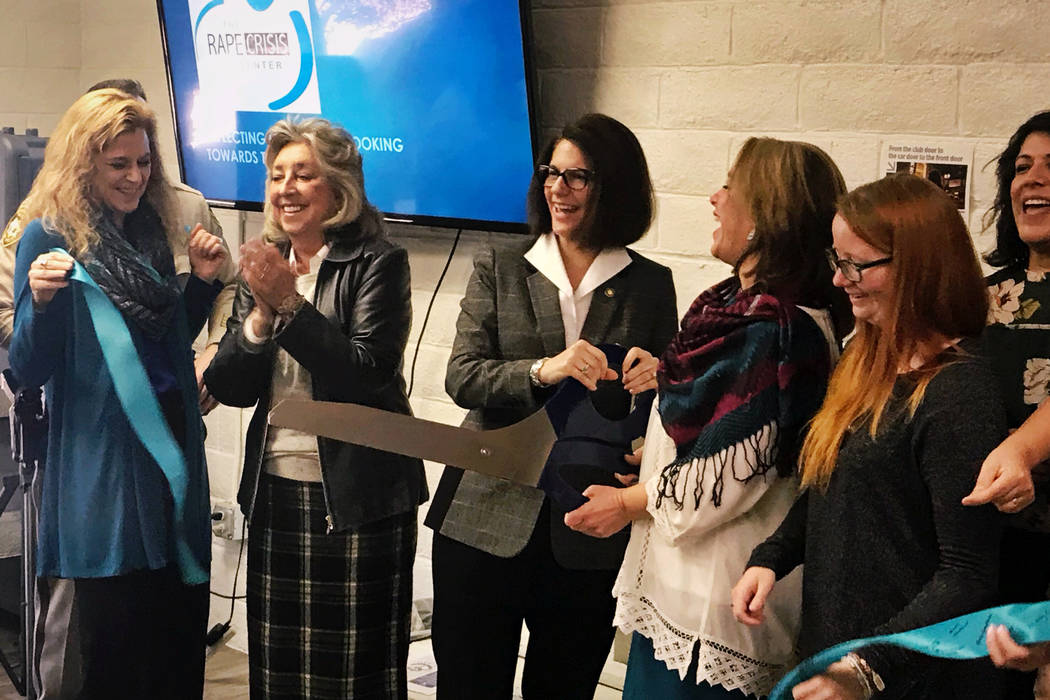 U.S. Sen. Catherine Cortez Masto, center, cuts the ribbon for the grand opening of the new, larger Rape Crisis Center office in Las Vegas on Tuesday, Feb. 19, 2019. The organization's executive ...