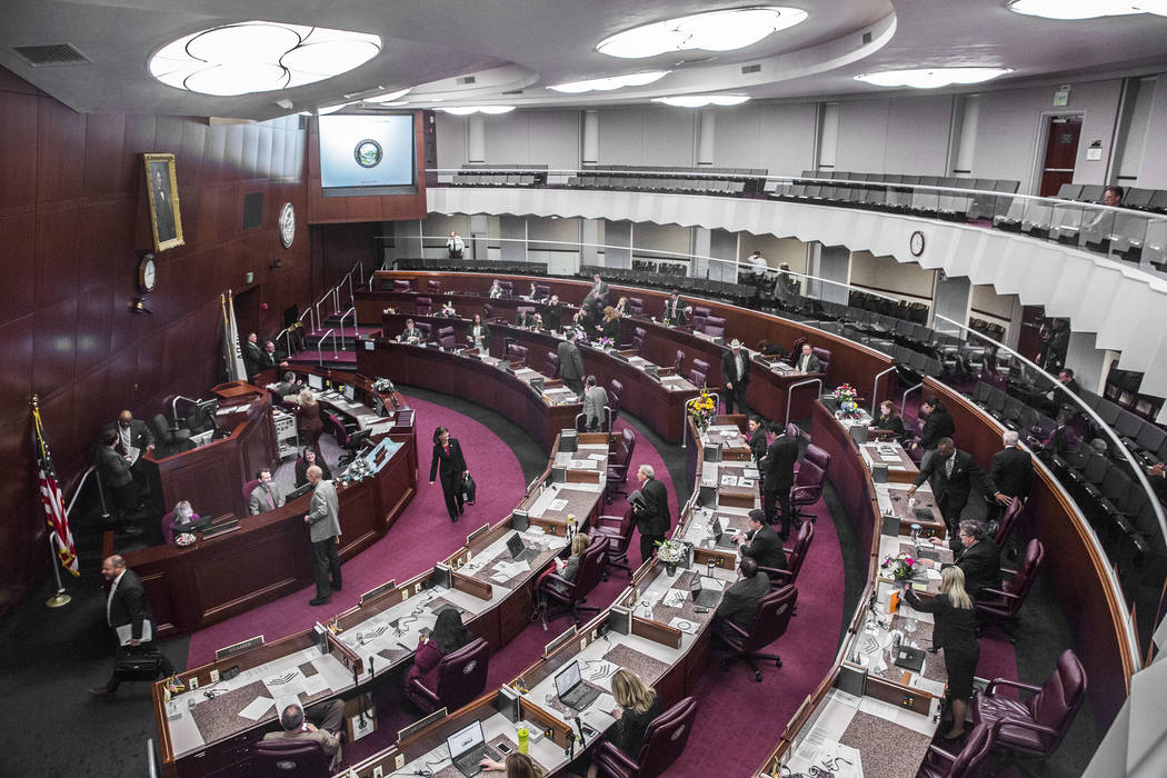 Members of the assembly file out of chambers. (Benjamin Hager/Las Vegas Review-Journal) @benjaminhphoto