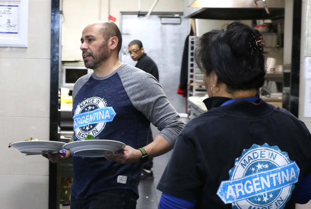 Made in Argentina restaurant owner Pablo Rodriguez serves lunch on Tuesday, Feb. 19, 2019, in Las Vegas. A thief stole $10,000 worth of cash, electronics, and empanadas when he broke into Rodrigue ...