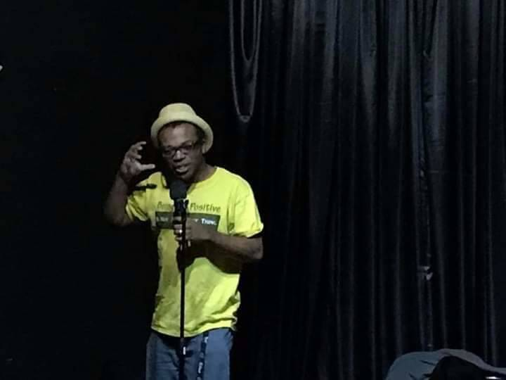 """Brandon Cox Sanford performs his HIV comedy skit as """"Andy Feds"""" at the Center for Science & Wonder in November 2018. (Brandon Cox Sanford)"""