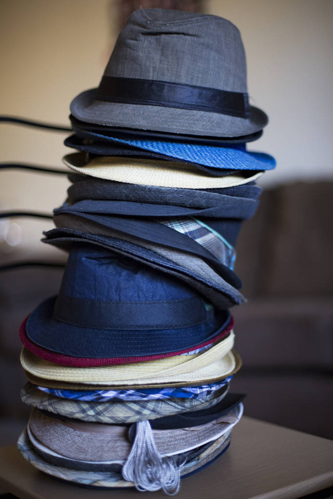 Comedian Brandon Cox Sanford's signature fedoras at his home in Henderson, Tuesday, Feb. 19, 2019. Cox Sanford was born with HIV and brings it up in his standup sets to destigmatize the virus. (Ra ...