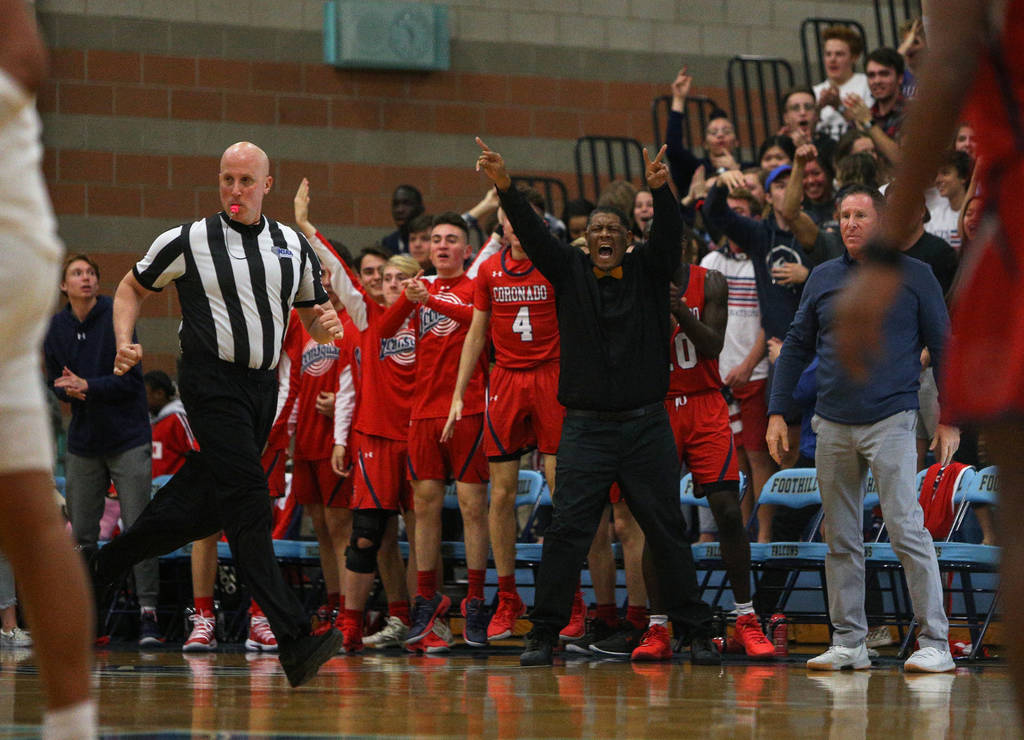 Coronado's bench cheers on the team as they play against Bishop Gorman High School during the Desert Region boys semifinal game at Foothill High Schoo in Henderson, Tuesday, Feb. 19, 2019. (Caroli ...