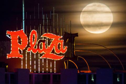 A super snow moon rises over the Plaza in downtown Las Vegas as seen from the World Market Cent ...