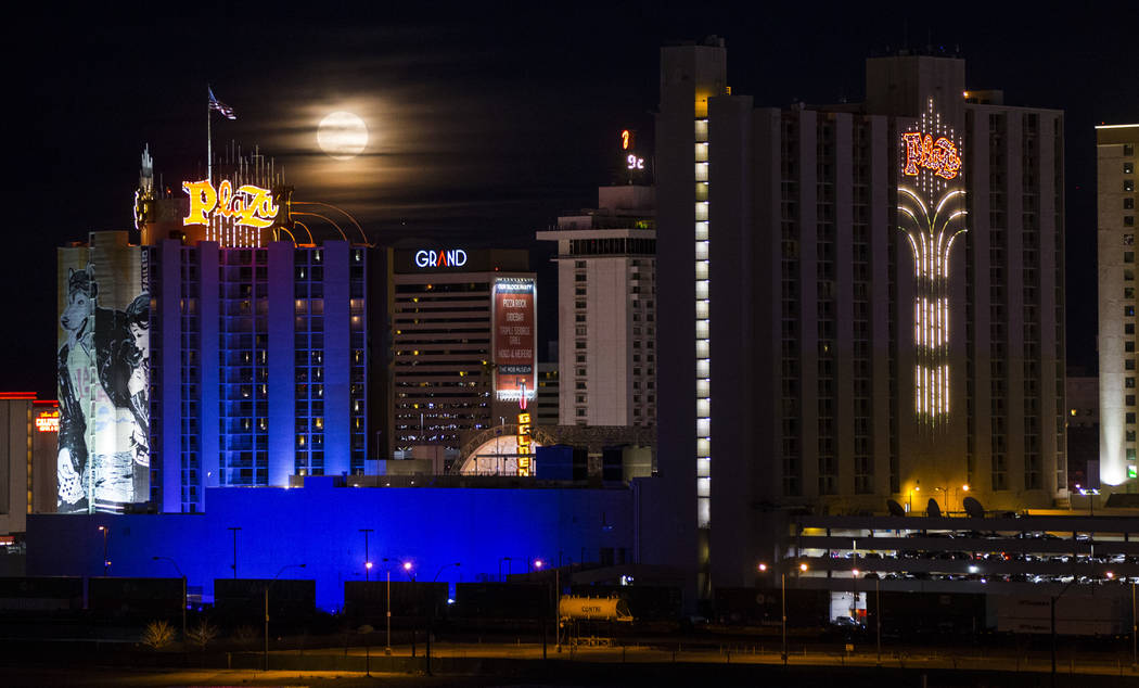 A super snow moon rises over the Plaza in downtown Las Vegas as seen from the World Market Center on Tuesday, Feb. 19, 2019. (Chase Stevens/Las Vegas Review-Journal) @csstevensphoto
