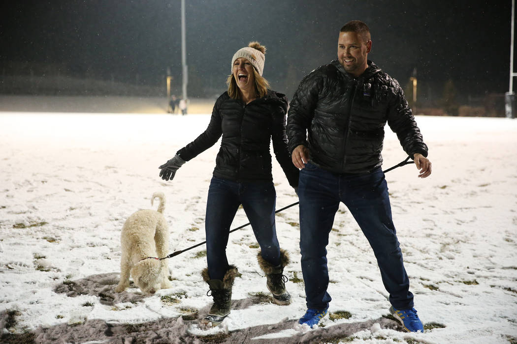 Andrea Mott, left, and her husband Joey, with their dog Bo, of Las Vegas, play at the Skye Canyon Park in Las Vegas, Wednesday, Feb. 20, 2019. (Erik Verduzco/Las Vegas Review-Journal) @Erik_Verduzco
