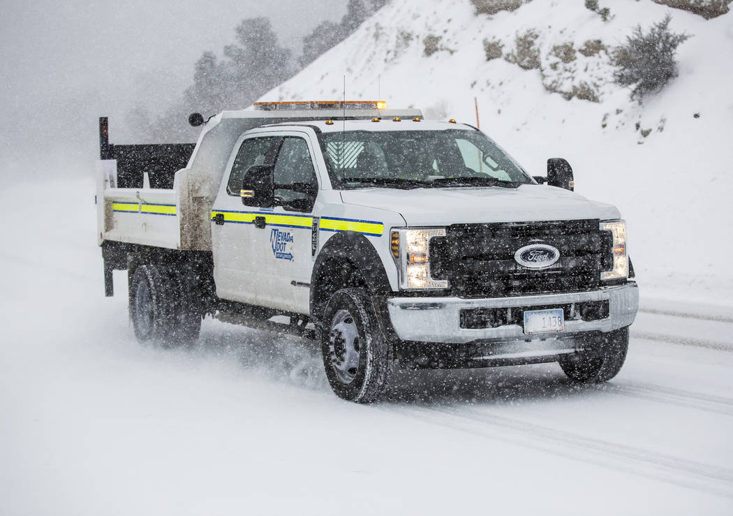 A Nevada Department of Transportation vehicle drives in heavy snow at Mount Charleston on Wednesday, Feb. 20, 2019, outside Las Vegas. (Benjamin Hager Review-Journal) @BenjaminHphoto