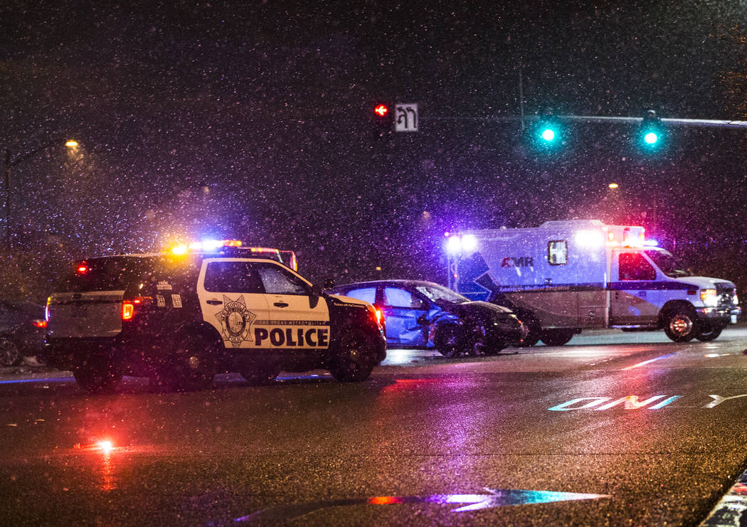 Las Vegas Metro works to secure the scene of an accident at North Durango Drive and West Centennial Parkway in heavy snow on Wednesday, Feb. 20, 2019, in Las Vegas. (Benjamin Hager Review-Journal) ...