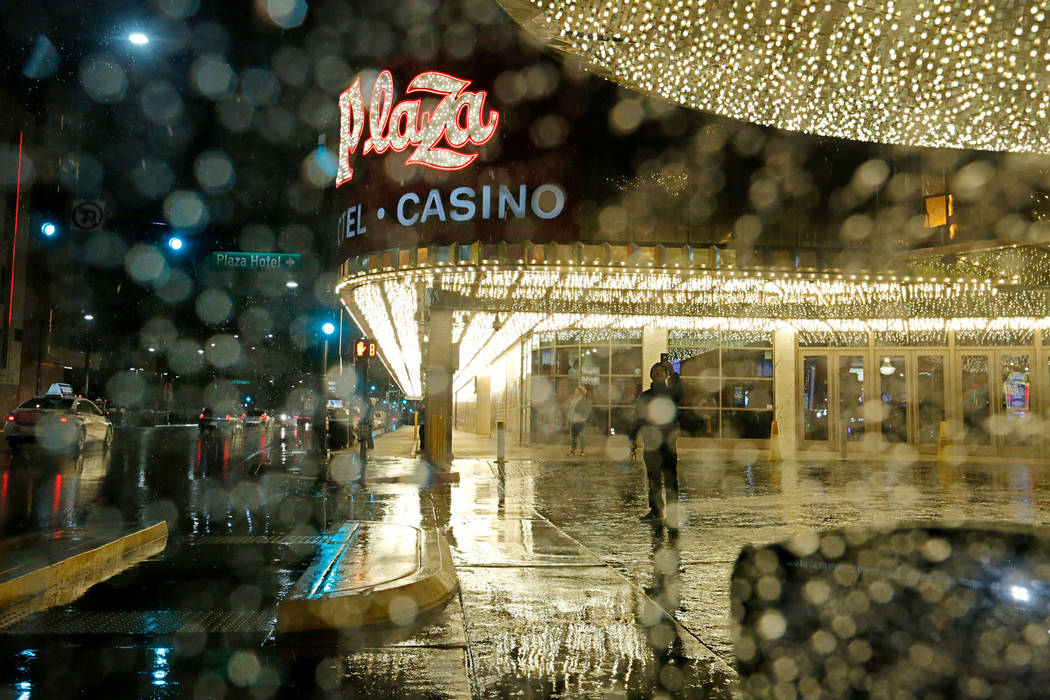 A man takes photos as snow falls in downtown Las Vegas, Wednesday, Feb. 20, 2019. (Chitose Suzuki / Las Vegas Review-Journal) @chitosephoto