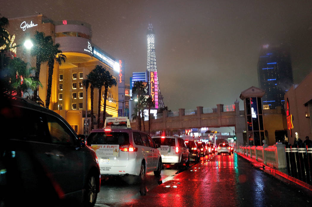 Cars go through the Strip in Las Vegas as snow falls, Wednesday, Feb. 20, 2019. (Chitose Suzuki / Las Vegas Review-Journal) @chitosephoto