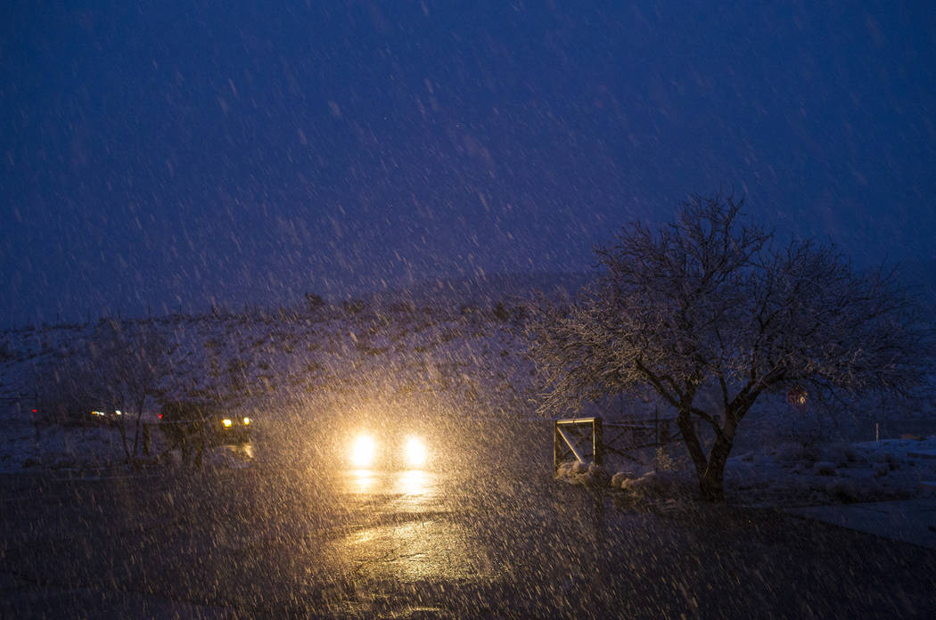 Vehicles pull into the overlook at the Red Rock Canyon National Conservation Area as snow falls outside of Las Vegas on Wednesday, Feb. 20, 2019. (Chase Stevens/Las Vegas Review-Journal) @cssteven ...
