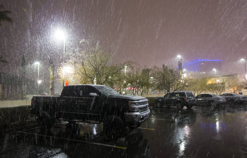 Snow falls around Downtown Summerlin in Las Vegas on Wednesday, Feb. 20, 2019. (Chase Stevens/Las Vegas Review-Journal) @csstevensphoto
