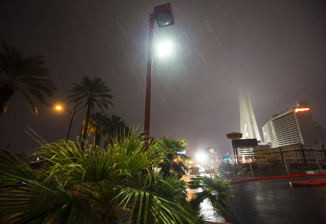 The Strat is obscured in the background as snow falls in Las Vegas on Wednesday, Feb. 20, 2019. (Chase Stevens/Las Vegas Review-Journal) @csstevensphoto