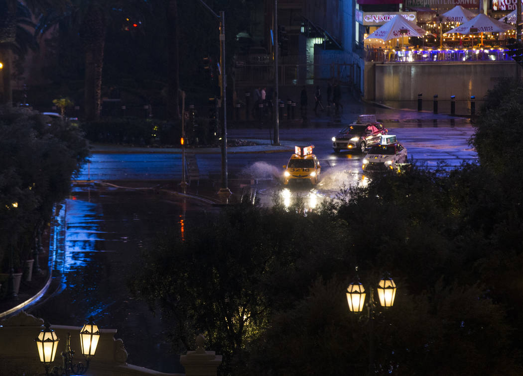 Taxis pull into the Bellagio as snow falls in Las Vegas on Wednesday, Feb. 20, 2019. (Chase Stevens/Las Vegas Review-Journal) @csstevensphoto