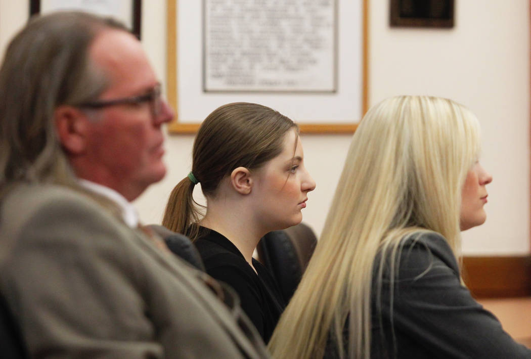 Cheyanne Harris, center, sits with defense attorneys Aaron Hawbaker and Nichole Watt during the second day of Harris' murder trial in Le Mars, Iowa, Thursday, Jan. 31, 2019. (Jeff Reinitz/The Cou ...