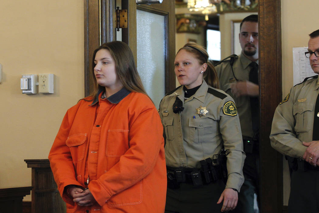Cheyanne Renae Harris, left, enters the courtroom prior to sentencing Tuesday, Feb. 19, 2019, in New Hampton, Iowa. (Jeff Reinitz/Waterloo-Cedar Falls Courier via AP)