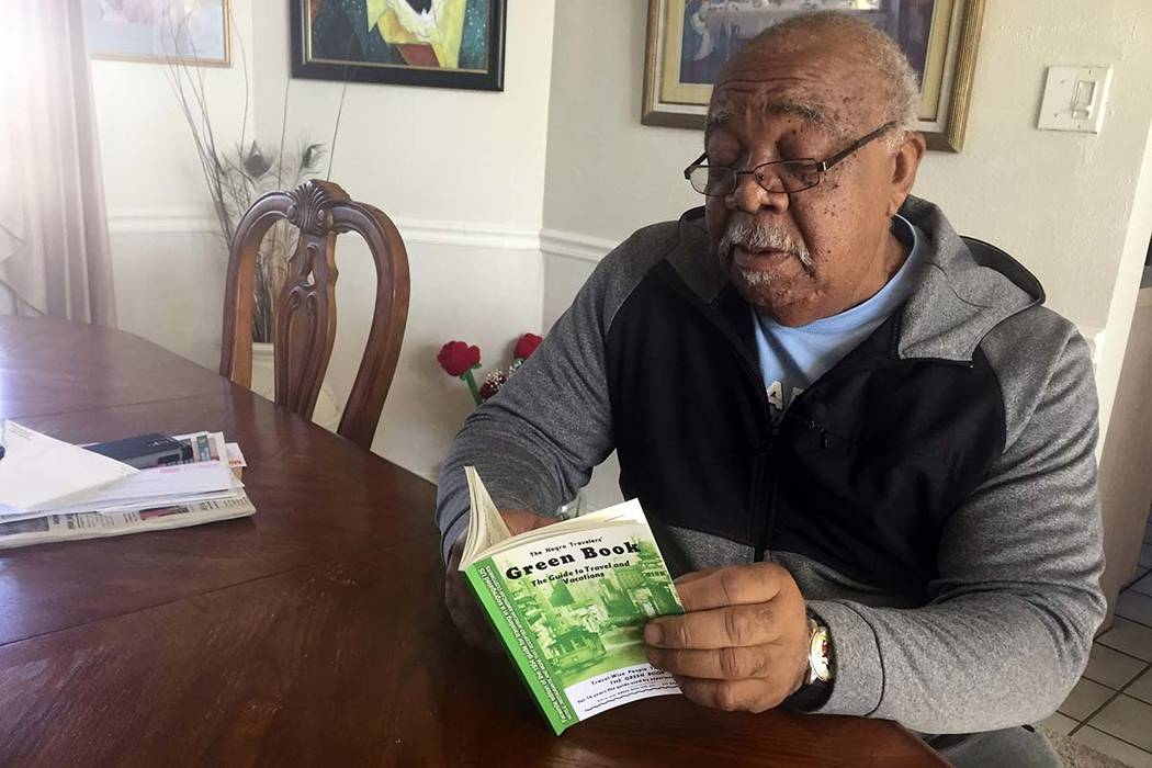 """In this Jan. 31, 2019 photo, Charles Becknell, Sr., 77, holds a copy of 1954 the edition of """"The Negro Motorist Green Book"""" at his home in Rio Rancho, New Mexico.The Oscar-nominated interracial ro ..."""