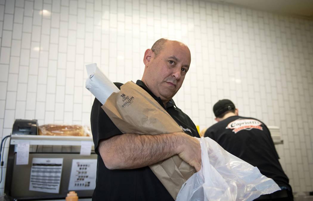 Franchise owner Michael Solomon gets food ready for a customer at Capriotti's Sandwich Shop in Las Vegas, Wednesday, Feb. 20, 2019. (Caroline Brehman/Las Vegas Review-Journal) @carolinebrehman