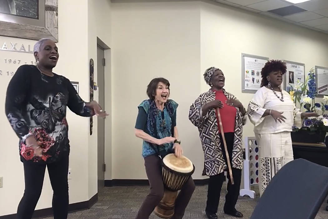 """Rochelle Hooks, from left, president of the Nevada Writing Guild, leads a song alongside Karla Hunstman, Binnie Tate Wilkin and Judy-Ann Young at the """"Stories from the Motherland"""" performance ..."""