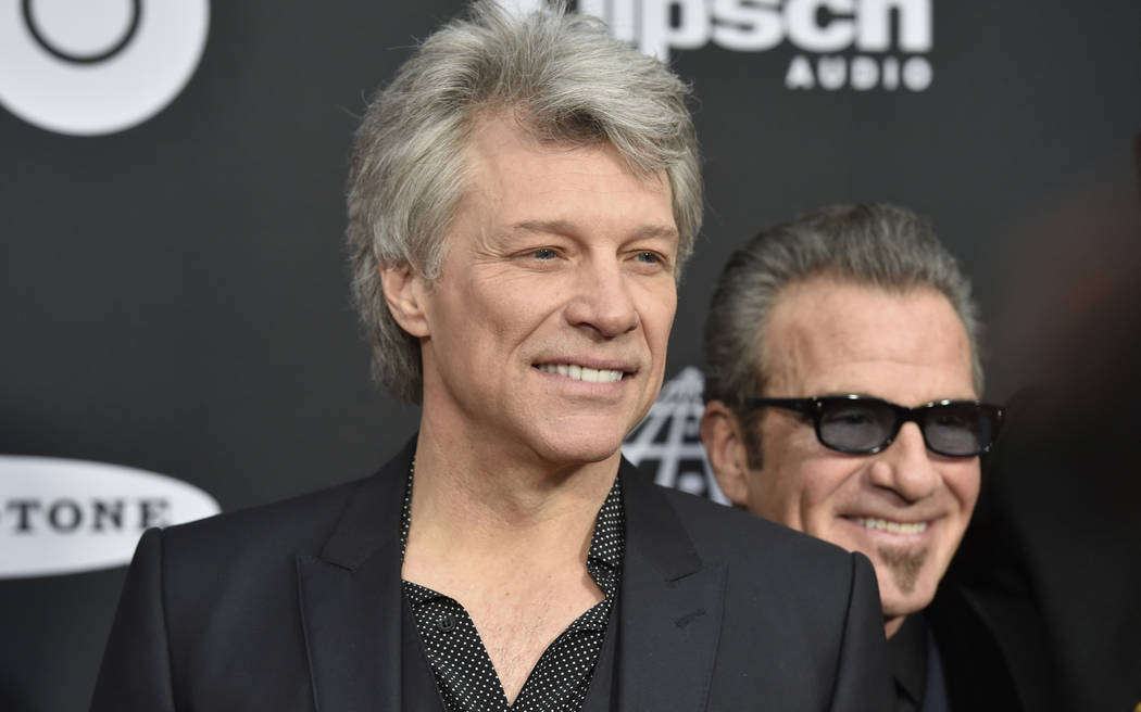 In this April 14, 2018 file photo, Jon Bon Jovi arrives at the red carpet before the Rock and Roll Hall of Fame induction ceremony in Cleveland. (AP Photo/David Richard, File)