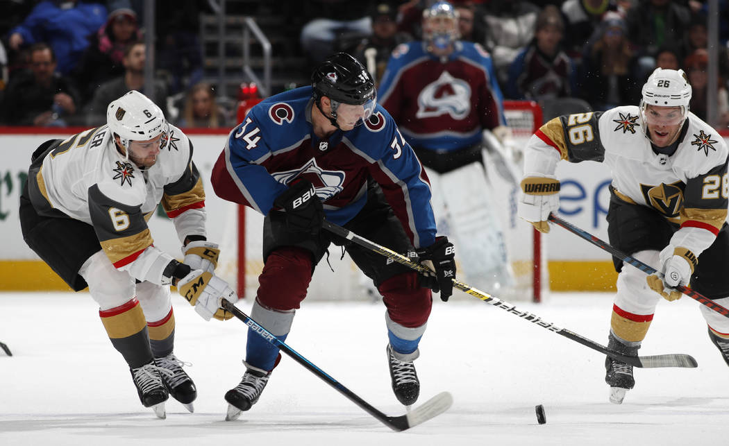 From left, Vegas Golden Knights defenseman Colin Miller, Colorado Avalanche center Carl Soderberg and Vegas center Paul Stastny pursue the puck in the third period of an NHL hockey game Monday, Fe ...