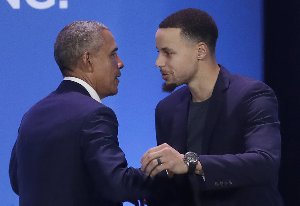 Former President Barack Obama, left, hugs Golden State Warriors basketball player Stephen Curry after speaking at the My Brother's Keeper Alliance Summit in Oakland, Calif., Tuesday, Feb. 19, 2019 ...