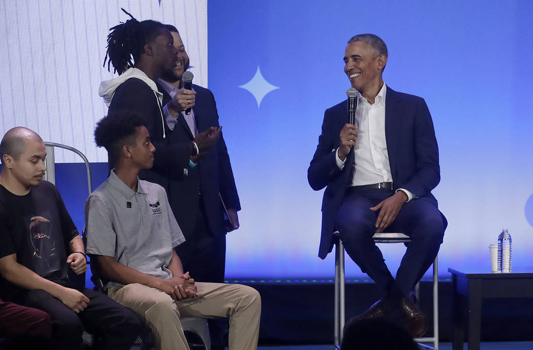 Former President Barack Obama, right, smiles while answering questions at the My Brother's Keeper Alliance Summit in Oakland, Calif., Tuesday, Feb. 19, 2019. (AP Photo/Jeff Chiu)